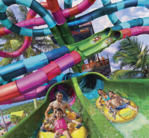 A father and daughter race their mother and son down Aquatica's newest dueling racer ride, Riptide Race—opening April 3, 2021!